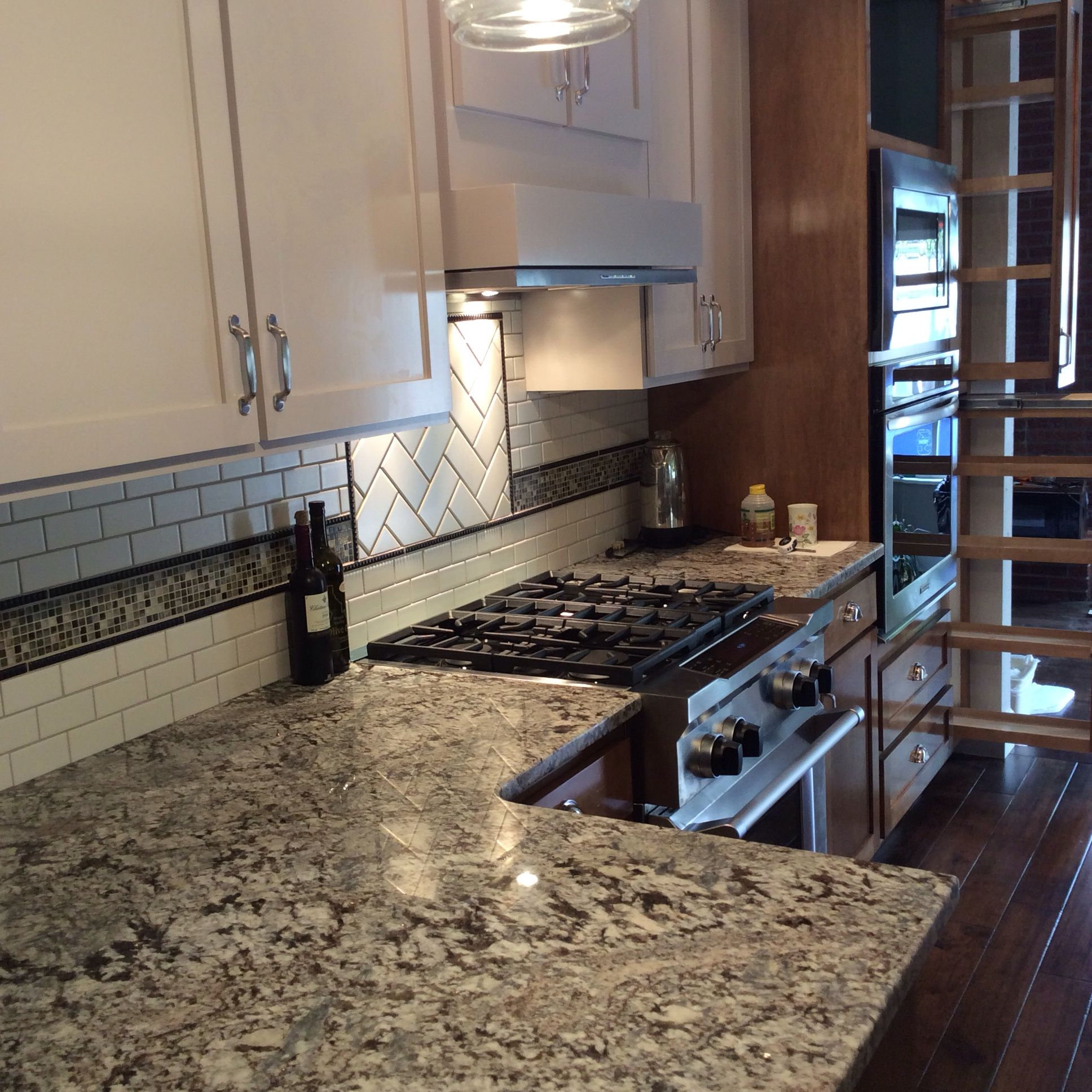 custom kitchen with lennon granite countertops, subway tile and