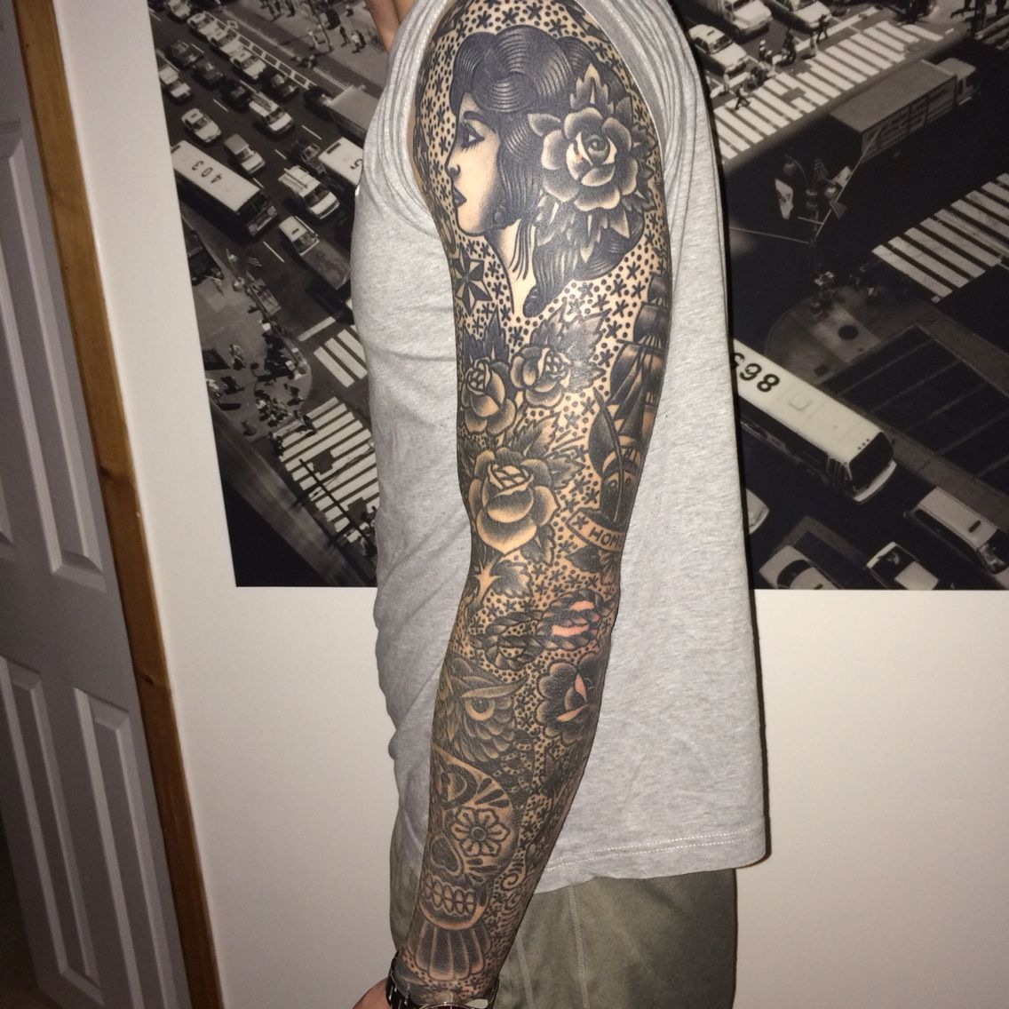 Traditional Black and Grey Sleeve Tattoo by Richie Clarke