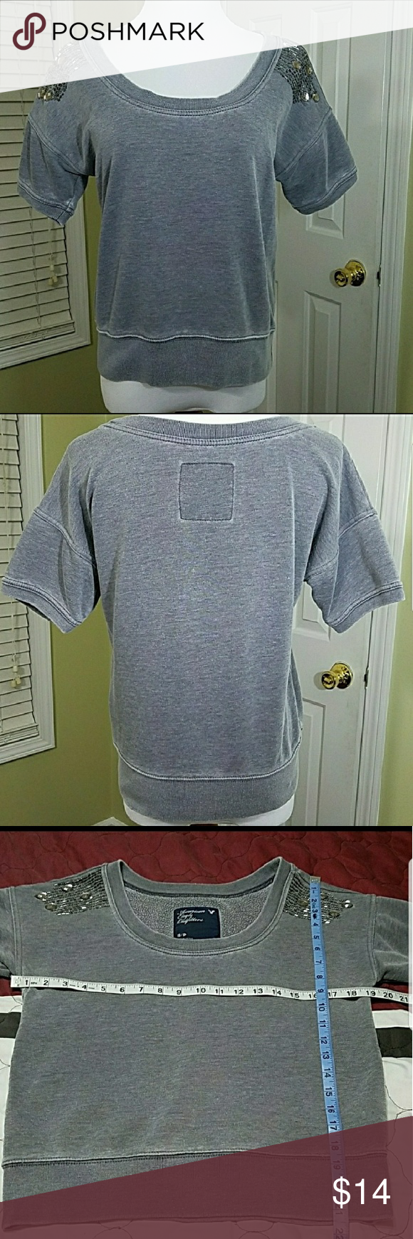 American eagle outfitters short sleeve sweatshirt American Eagle Outfitters short sleeve sweat shirt with embellishments at shoulders. In good condition.  Approximate measurement shown in pictures.  Materials shown in pictures. American Eagle Outfitters Tops