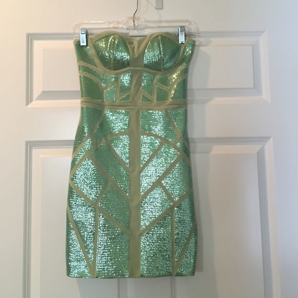 Super cute sea foam green sequin dress Tight but slimming green sequin patterned strapless dress! Only worn once, dry cleaned after use! Ark & Co Dresses