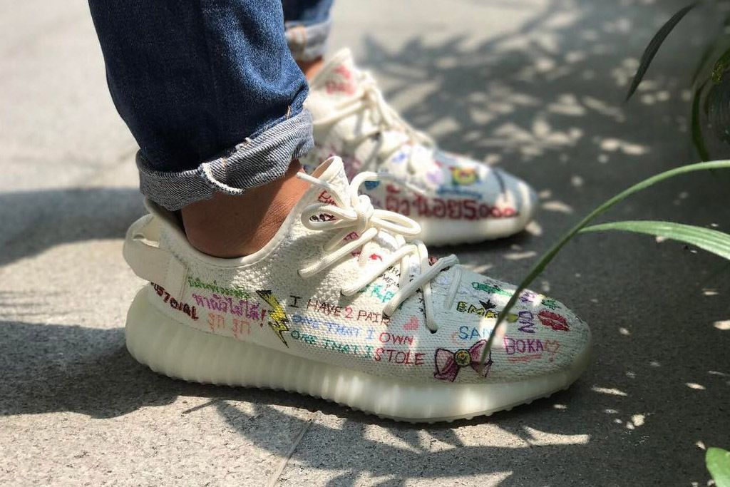 92dd7f3a2c47 Kanye West s  Cream White  Yeezy Boosts Get Covered in Doodles