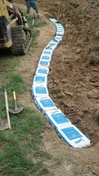 Start Of Sack Concrete Wall My Concrete Retaining Walls Concrete Bags Garden Projects