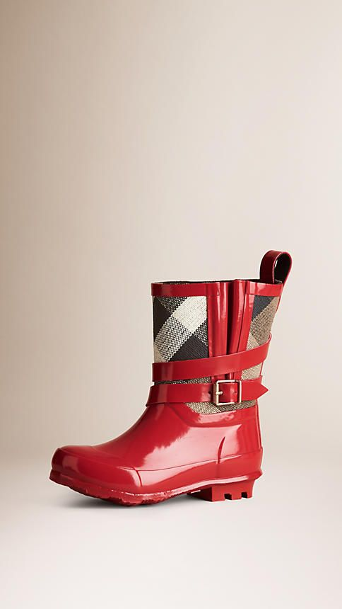 b6ecfcd27b5a Burberry Military Red Belted Check Rain Boots - Matte rubber rain boots  with wrapped strap and buckle detail. Check cotton panel. Inverted pleat  and matte ...