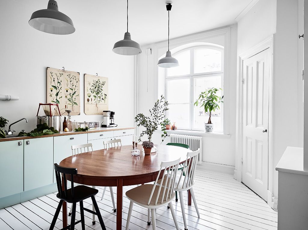 Bright white dining room with a vintage touch