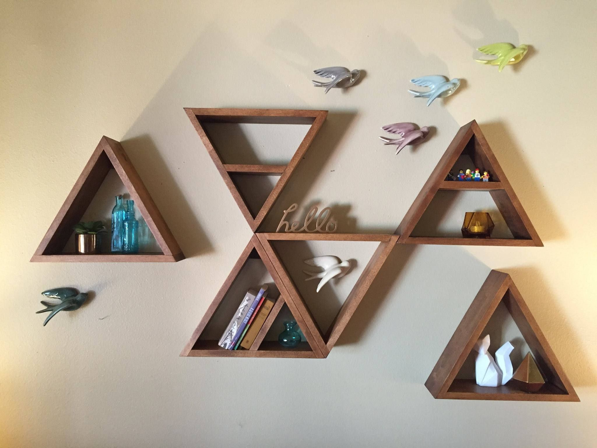 Homemade geometric shelves and wood signs. von