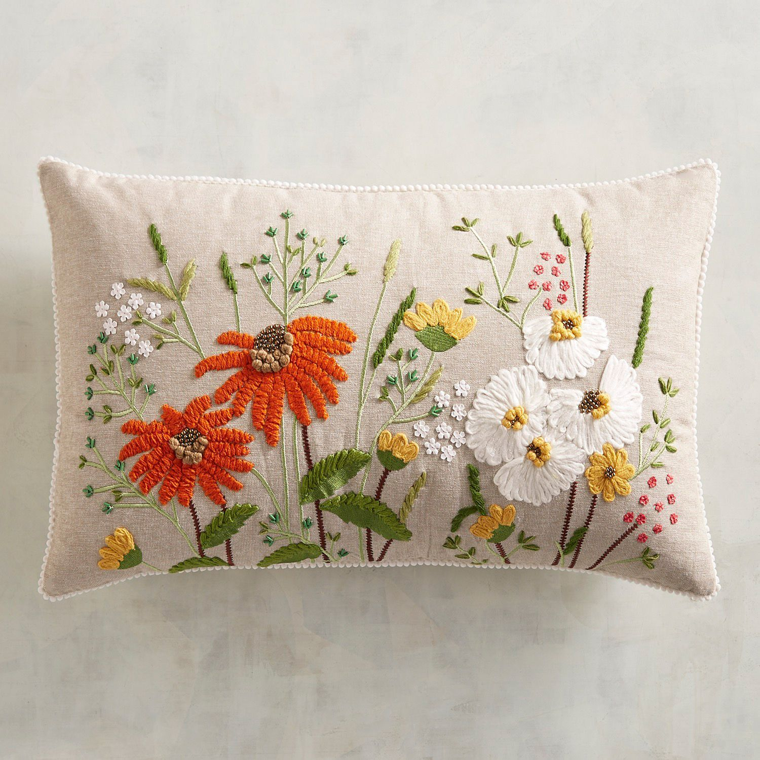 Embroidered throw pillow with a