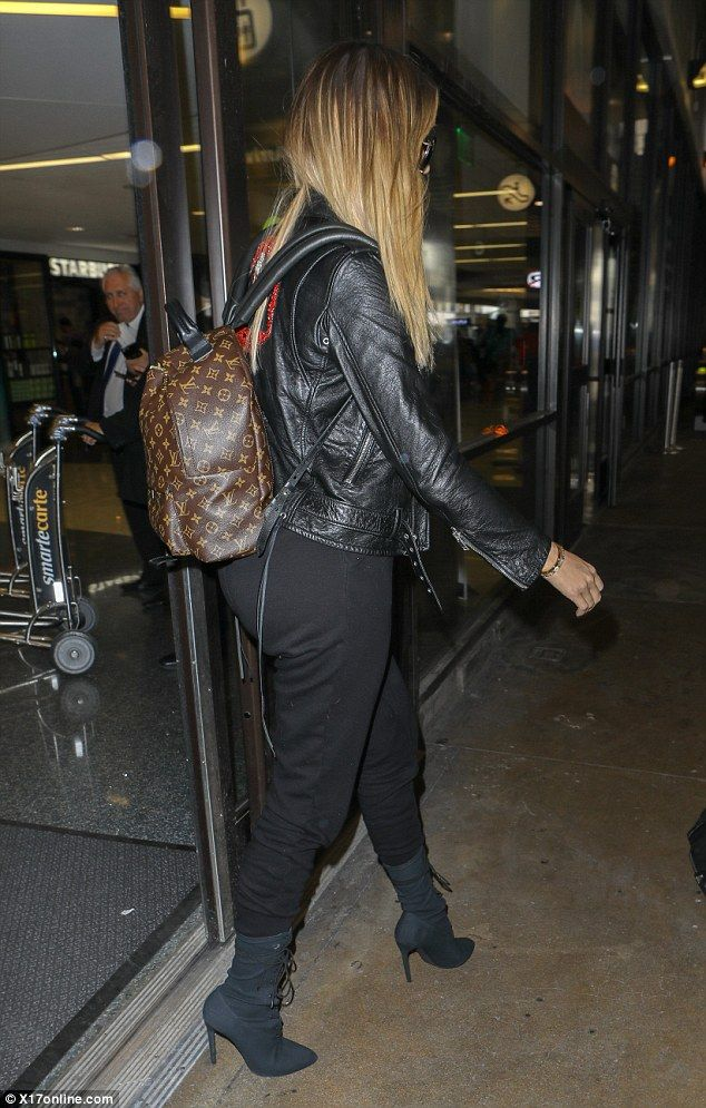 915872a3491 Go handsfree like Khloe in her Louis Vuitton  DailyMail Click  Visit  to  buy now