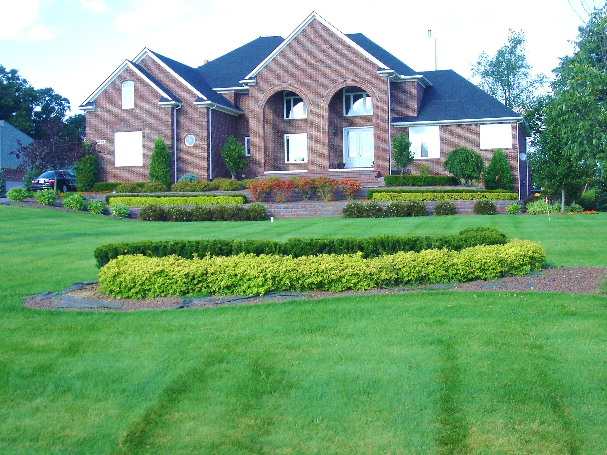 Beautiful Landscaping beautiful landscaping using double layer hedge with dense yew and