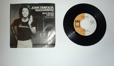"John Travolta record. Back then he was singing ""What would they say?"" I guess he knows now, huh?  LOL"