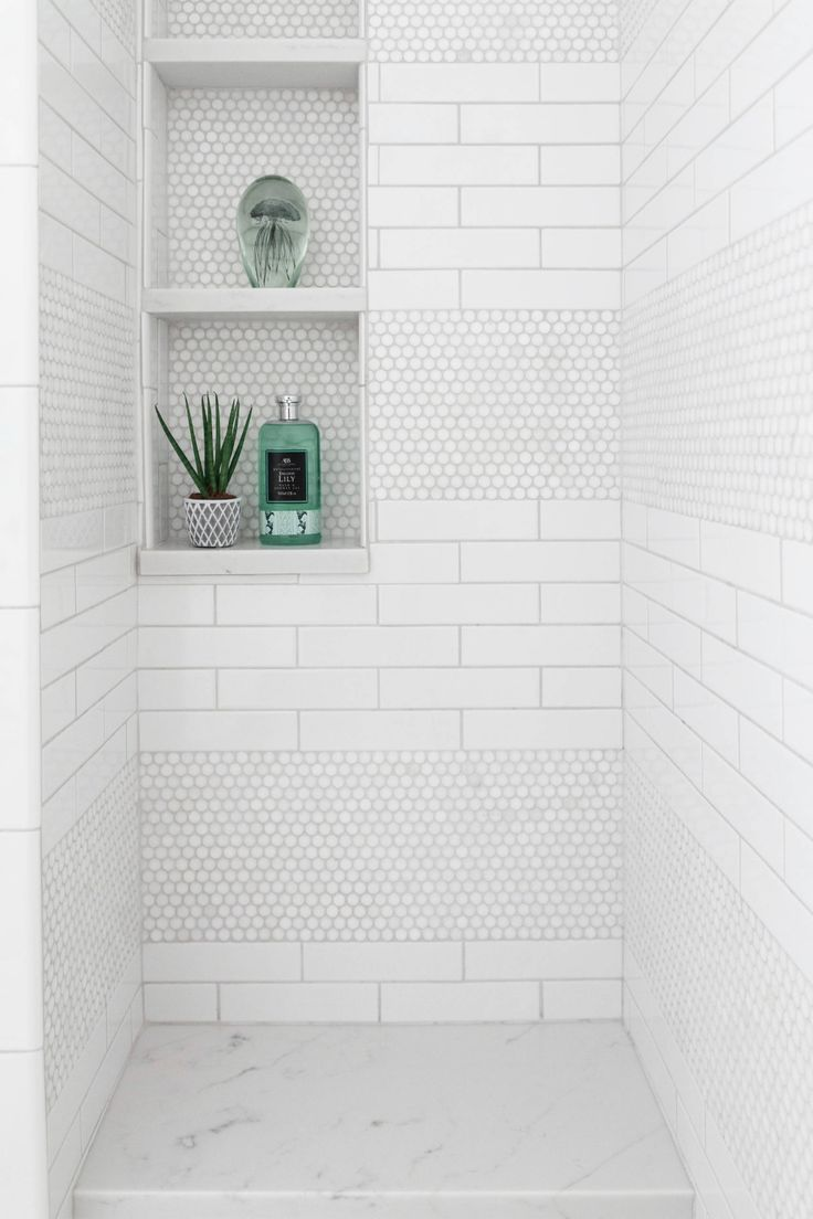 I'm loving this design idea for my next bathroom remodel! Really love how the statement mosaic tiles anchors this space while the clean white palate & cute niche accents adds a nice touch to complete the space!