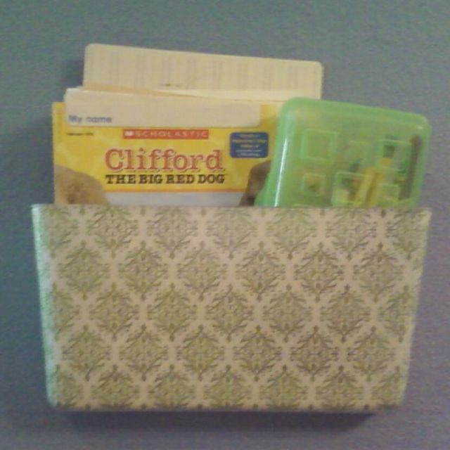 Clear letter organizer, covered with scrapbook paper & modge podge! Made the creative @Jennifer Scholte