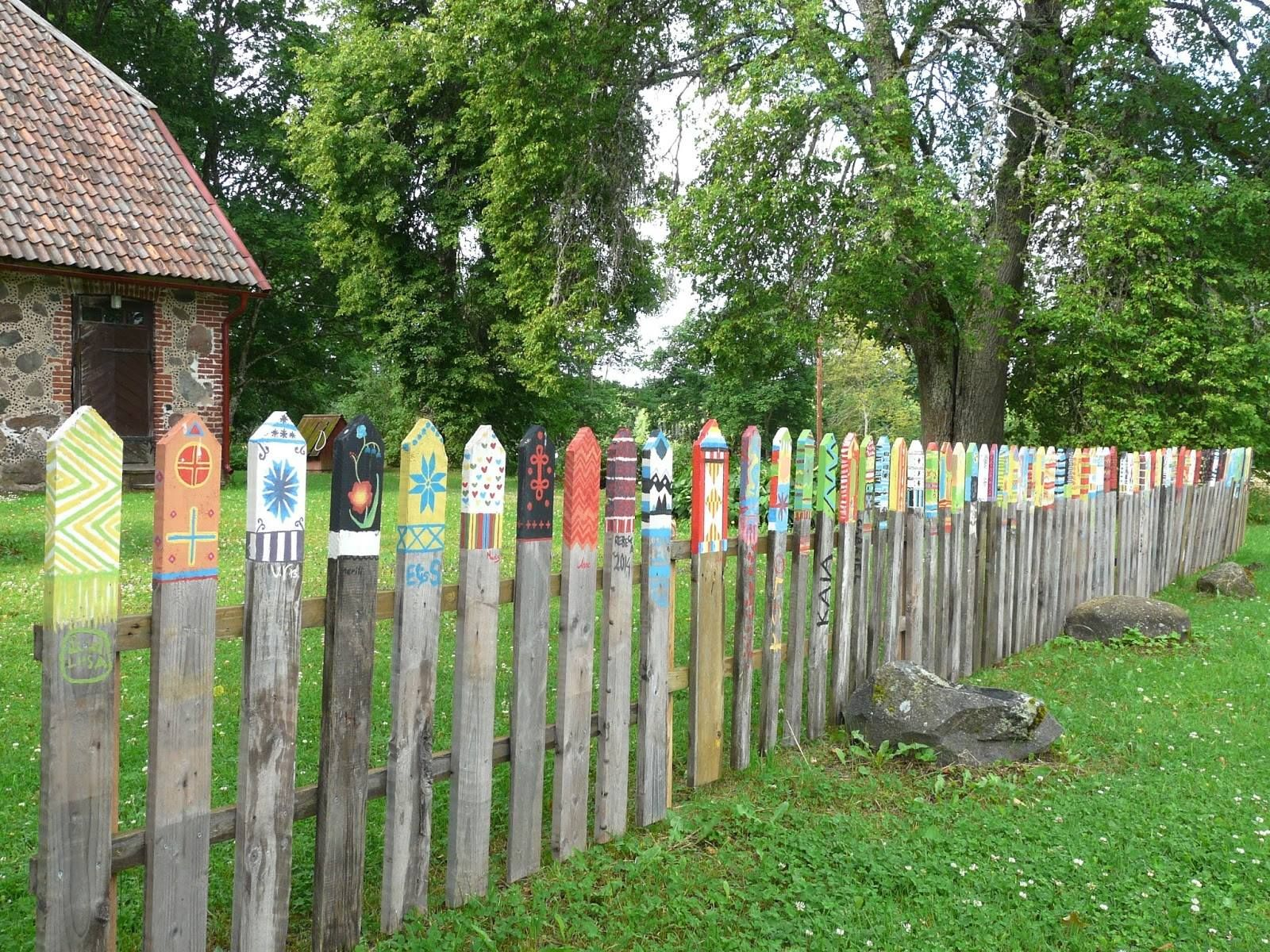 Traditional Estonian mitten designs on a fence Heimtali outside