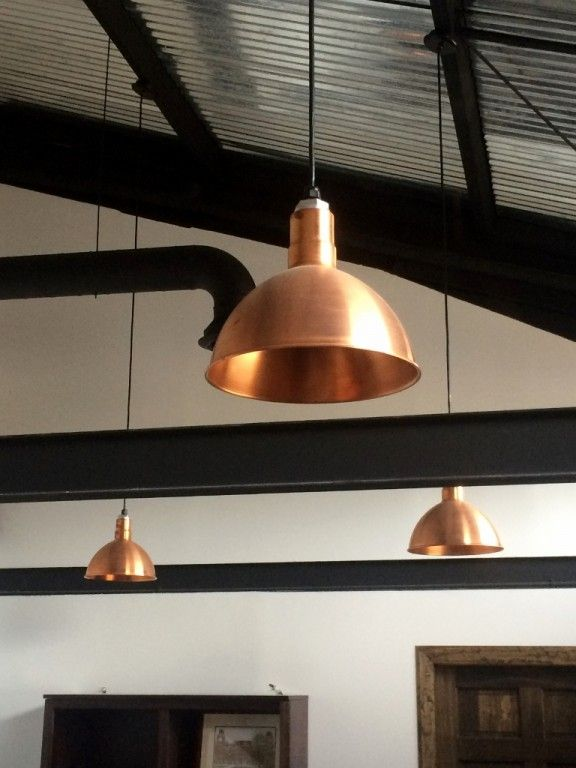 Copper Pendant Lighting Elevates Industrial Office Space Modern