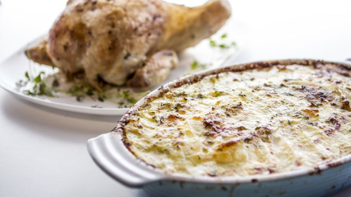 Layers of thinly sliced potatoes baked in cream, egg, herbs and cheese.... served with a golden roasted whole chicken. This is the kind of family food that people get jealous of. A true French classic!