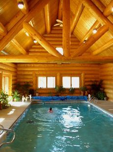 Indoor pool in log home cabin fever pinterest wishful thinking cabin and logs for Cottages in the lakes with swimming pools