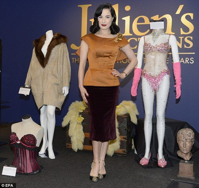 Madame hostess Dita posed alongside material from the Gypsy Rose Lee collection which will be auctioned off on December 6  sc 1 st  Pinterest & Dita Von Teese poses with Loni Anderson at gallery event in LA ...