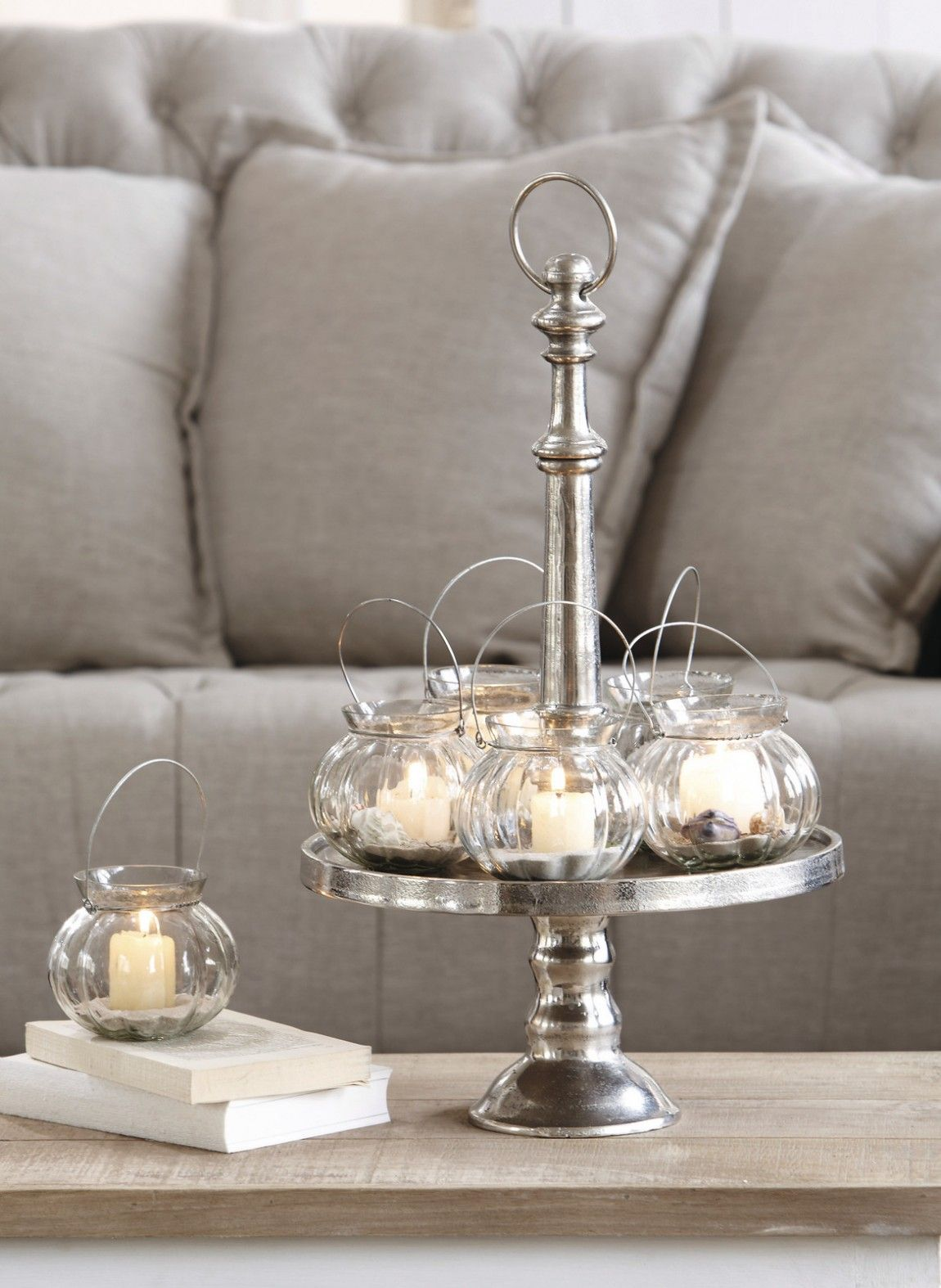 Pedestal cake stand used to display small lanterns for Riviera maison tisch