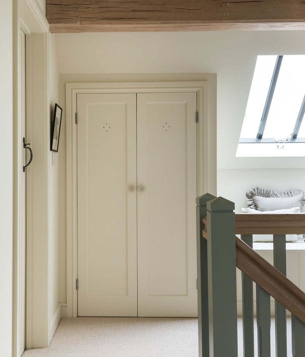 Loft bedroom fitted wardrobes  Border Oak fitted cupboards bespoke cupboards landing space oak