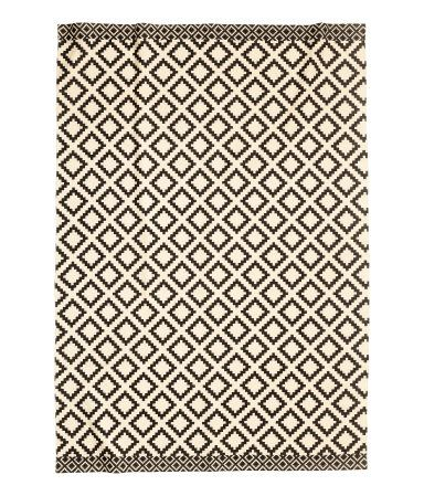 Large Cotton Rug With A Printed Pattern