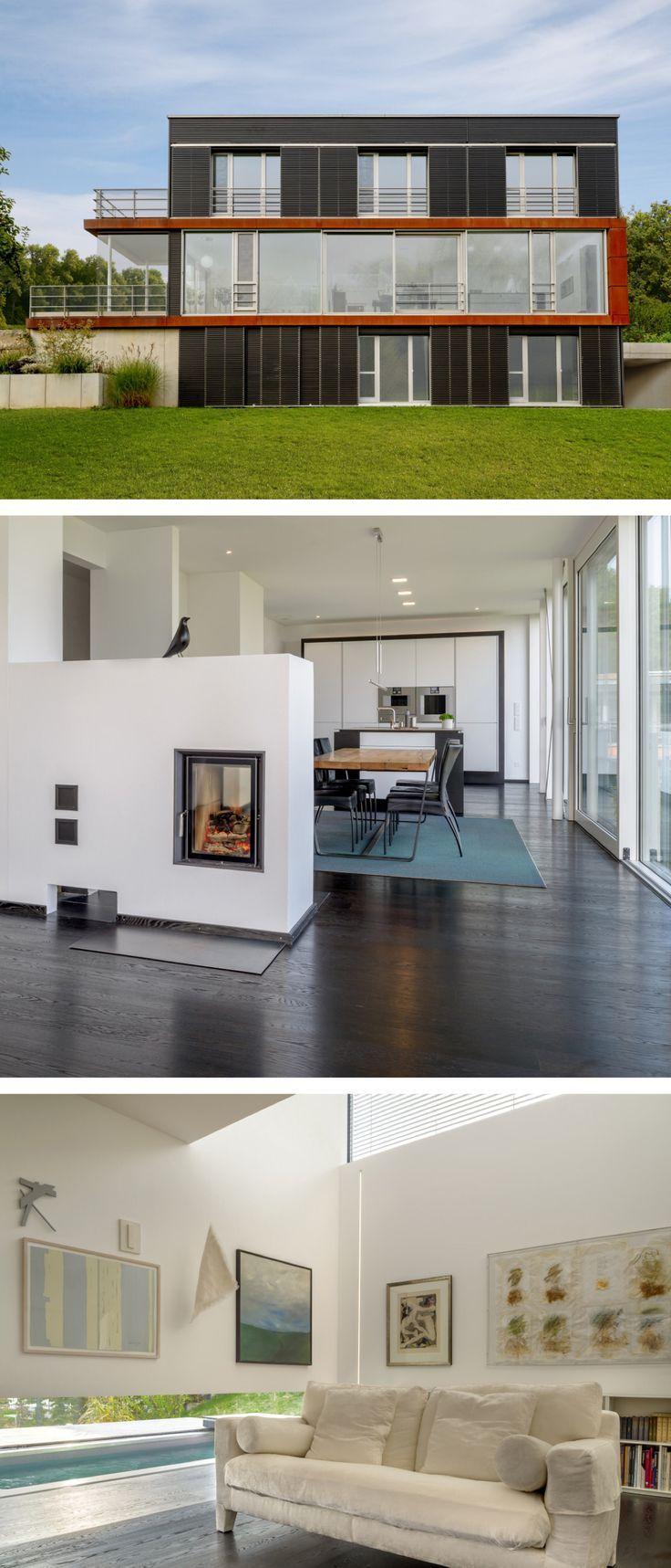 Modernes Architektenhaus mit Flachdach Architektur & Holz Fassade ...