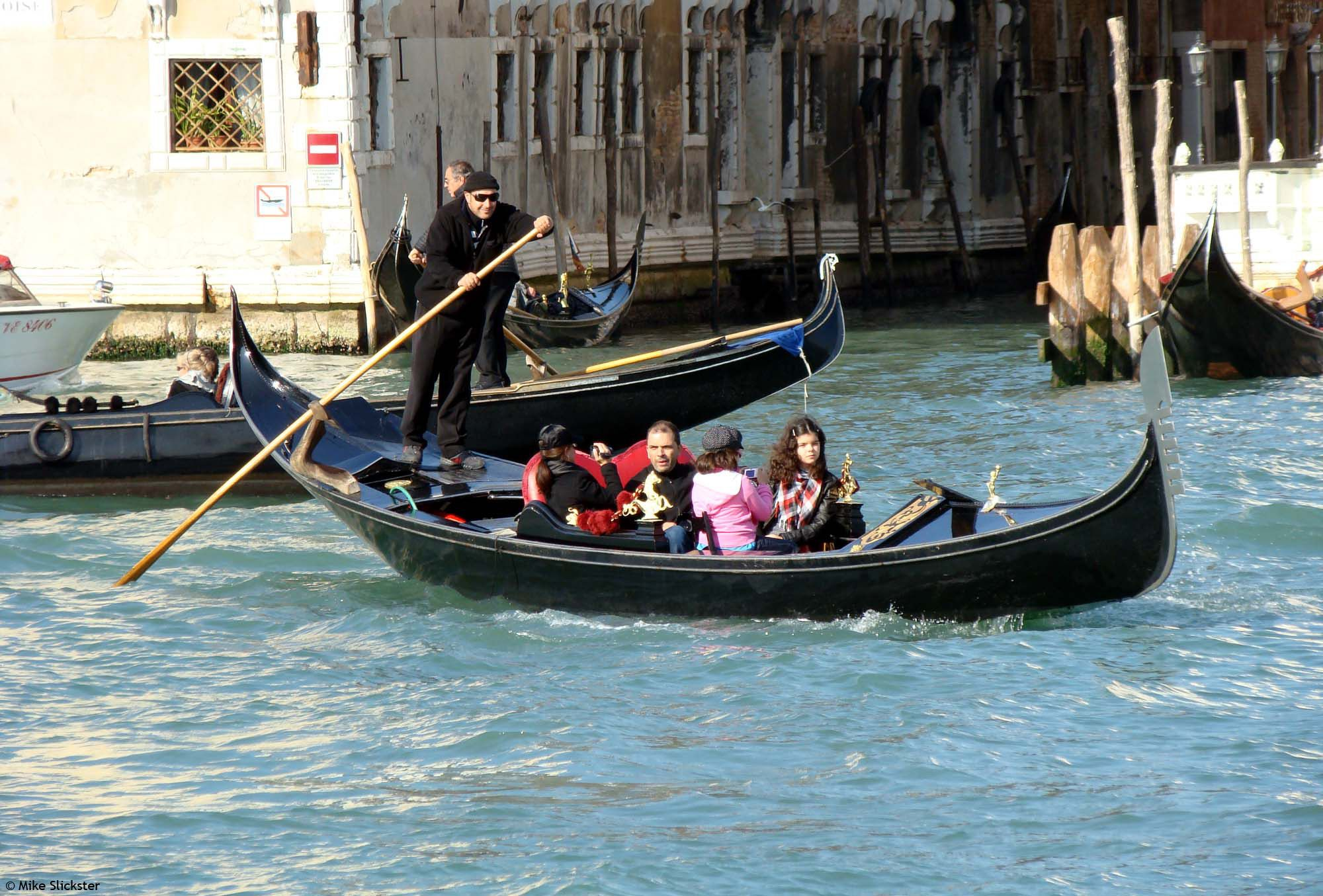 Gondola on the Grand Canal. Is it just me, or does the gondolier look like Randy Quaid?