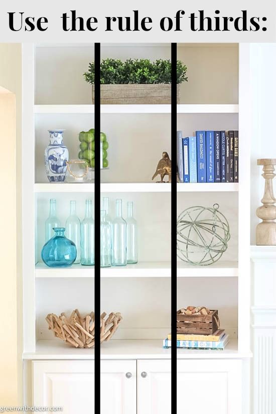 Wow, these bookshelves are GORGEOUS!! This post walks through how to decorate bookshelves from start to finish and has plenty of bookshelf decorating ideas if you're stuck! This rule of thirds is a game changer and makes decorating bookshelves SO much easier! If you're stumped on how to decorate a bookshelf, click through for the easy step by step guide for great looking bookshelves! #greenwithdecor #bookshelfdecorating #decoratingbookshelves #decorating #coastalstyle