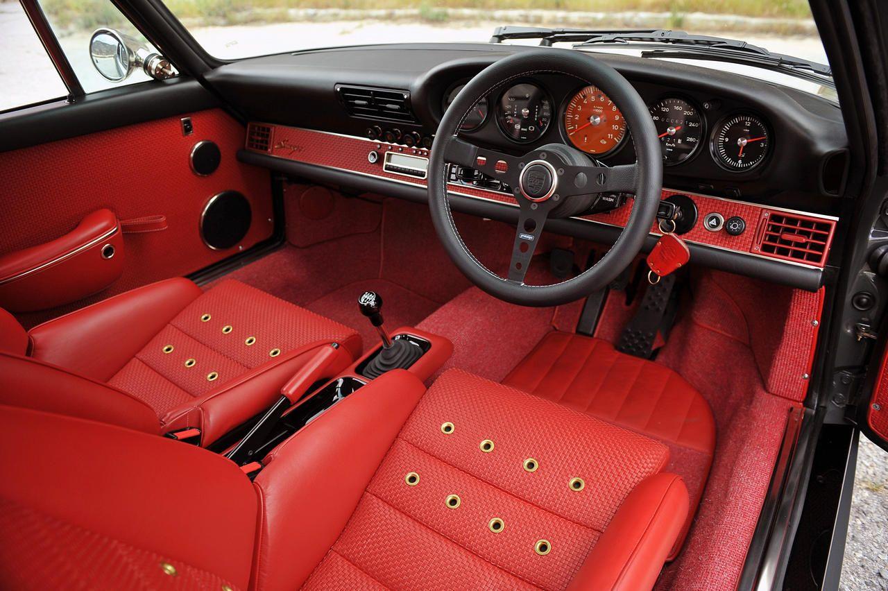 porsche Indonesia | Singer Vehicle Design red black grey interior gold grommets in seats RHD