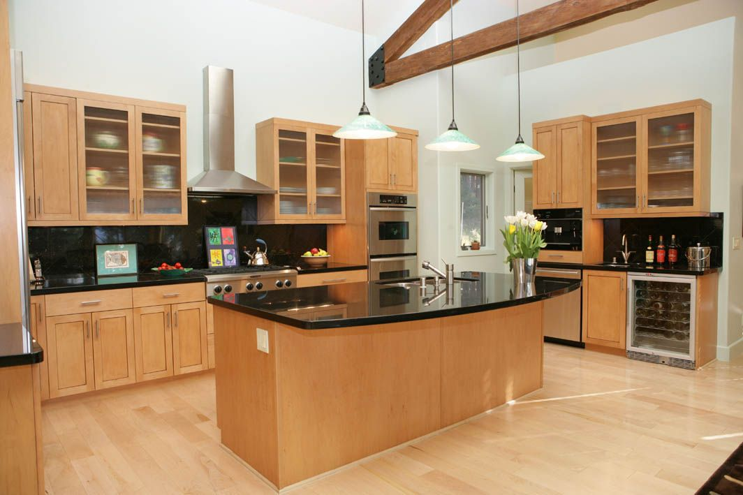 Modern kitchen with dark granite and light maple cabinets for Maple kitchen cabinets
