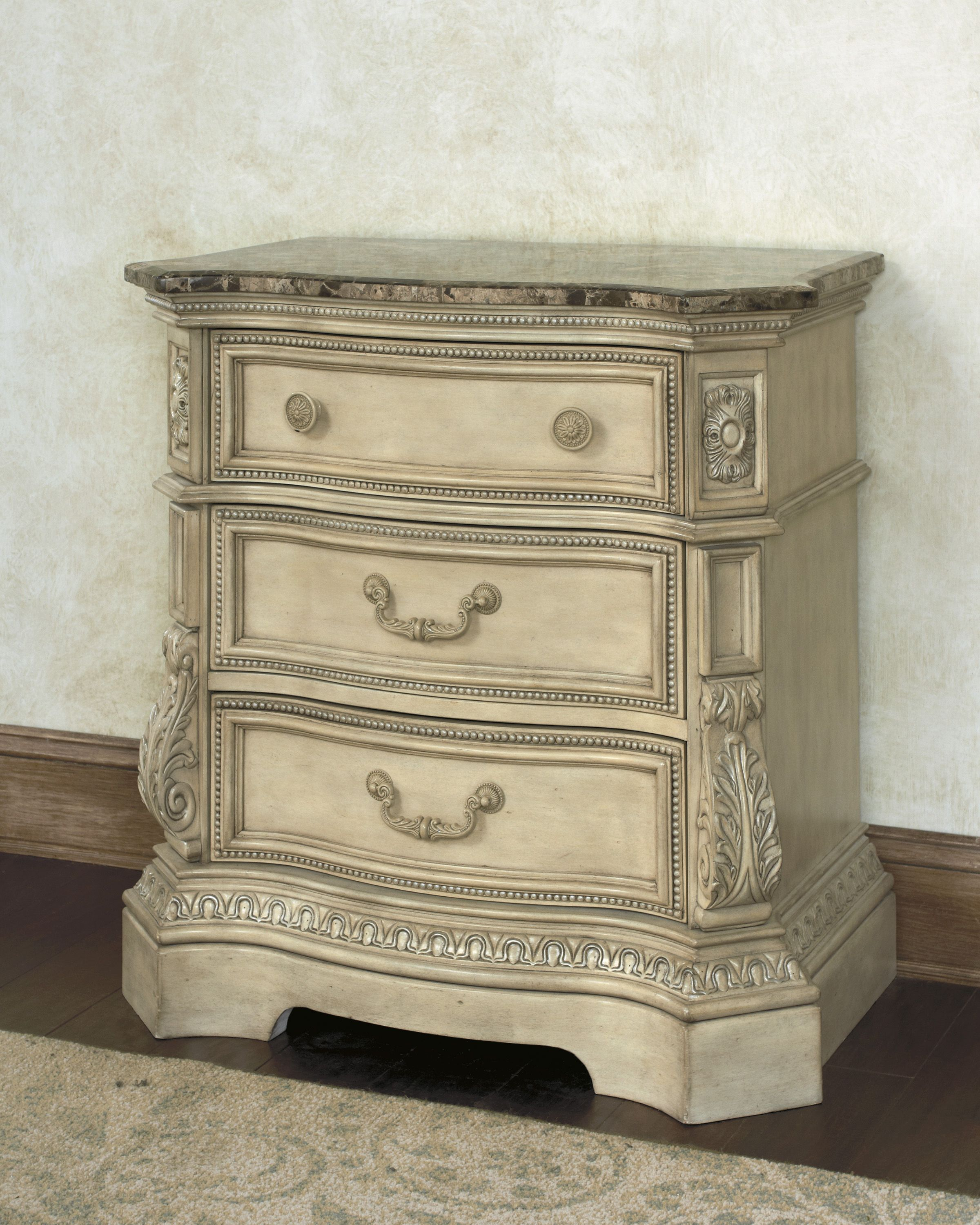 Three drawer nightstand with natural marble top. See the Ortaniqe Collection at Squan Furniture showrooms.