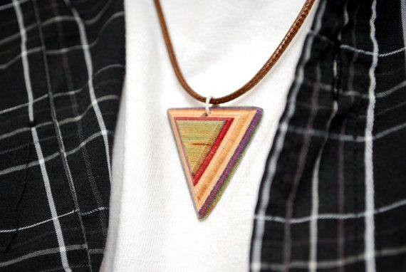 Recycled skateboard necklace - triangle pendant with brown synthetic leather cord.  This awesome piece of skateboard jewelry is exclusively available on our Etsy.  Made from recycled skateboard decks and other eco-friendly and animal-friendly products.