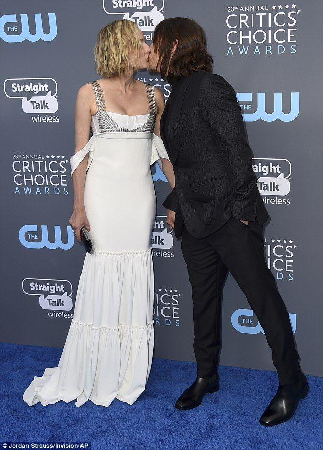 Diane Kruger and Norman Reedus KISS on CCA carpet Diane