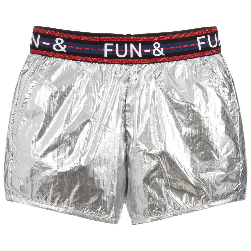 77faee7c0eaa5 Eye-catching, metallic silver shorts by Fun & Fun, with a glittery red and  blue elasticated logo waistband. They have useful side pockets and a navy  blue ...