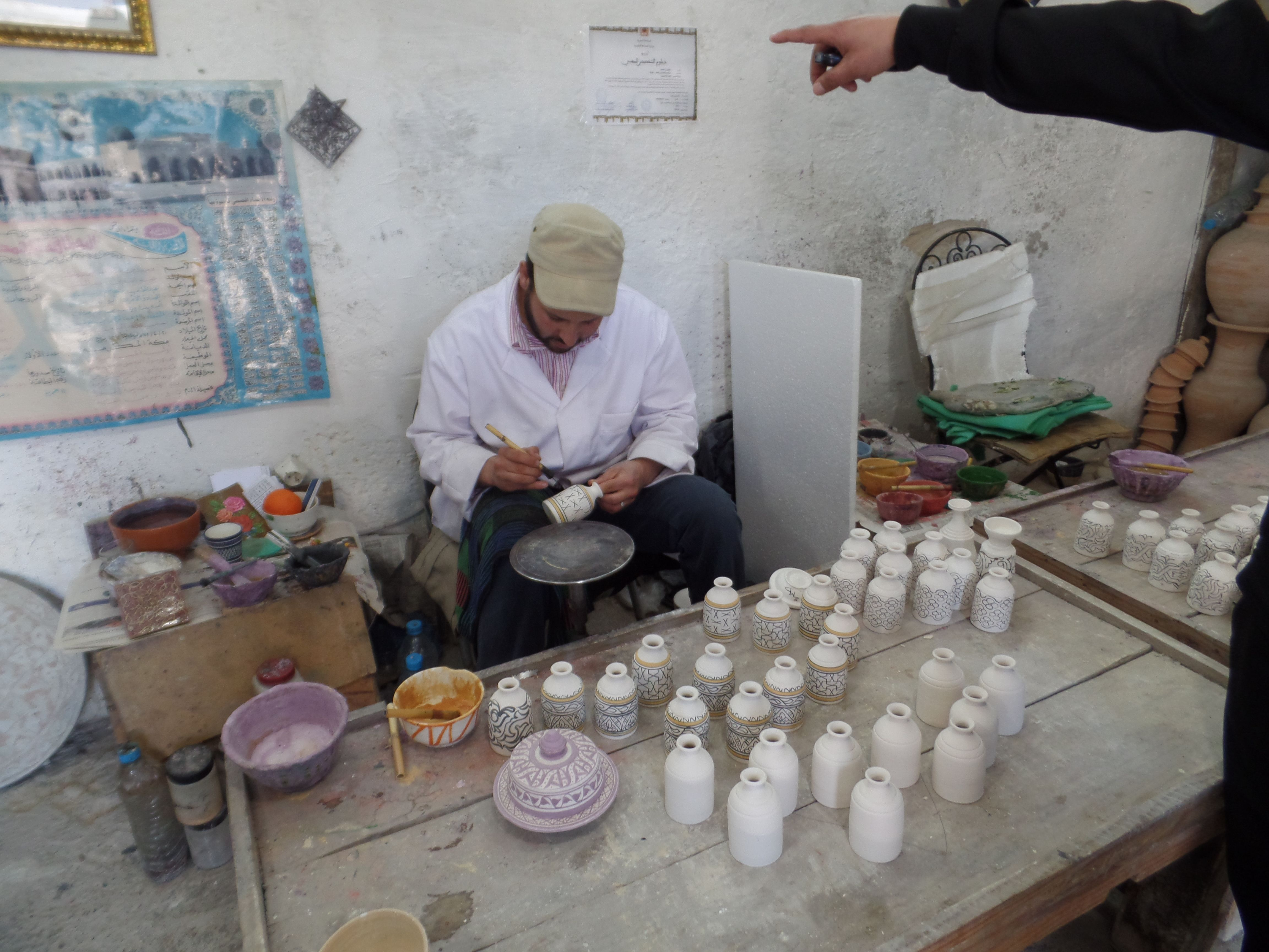 Fez Morocco. The pottery in the old Fez Medina. The artisans painstakingly create fine pieces of pottery.  www.exoticnomadictravel.com