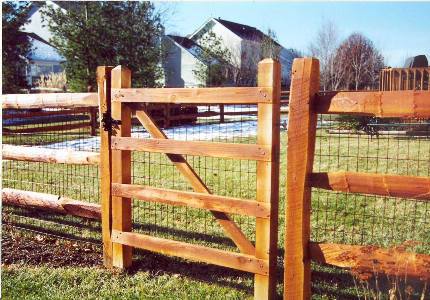wooden slat fence with metal posts for support rail fence wood fence
