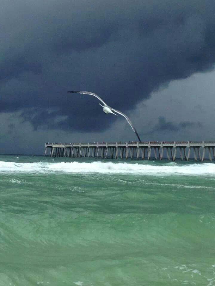 A storm approaches the pier at Pensacola Beach, Florida...