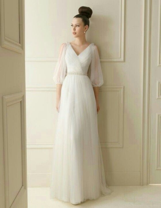 The unusual sleeves make this gown. It would also be beautiful on a pregnant bride.