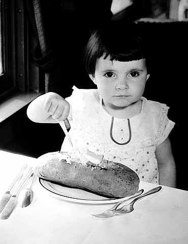 A young girl eating the famous