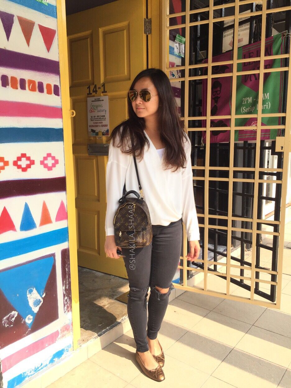 46a2d3bd4eb3 Sunny day in Subang Wrapped white top with black ripped jeans Bag from Louis  Vuitton. The Palm Springs Mini Backpack!