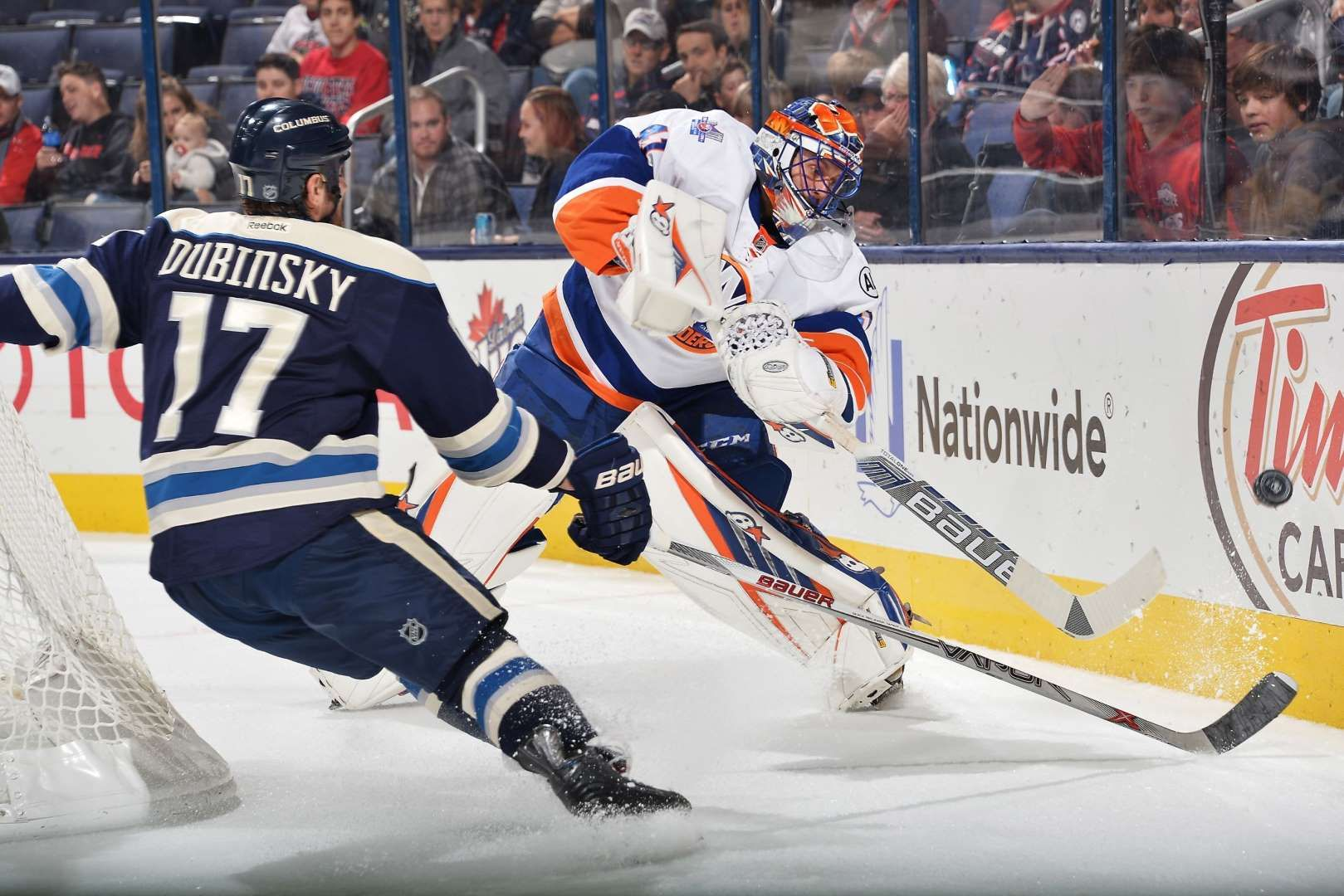 Halak handles the puck:   Goaltender Jaroslav Halak of the New York Islanders clears the puck away from Brandon Dubinsky of the Columbus Blue Jackets during the first period of a game on Dec. 12 at Nationwide Arena in Columbus, Ohio.  -     © Jamie Sabau/NHLI/Getty Images
