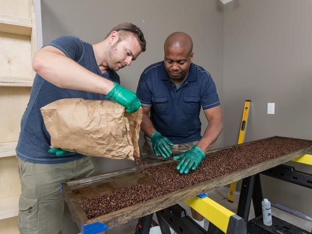 Matt and Grundy build a coffee bean backsplash for the sitting area.