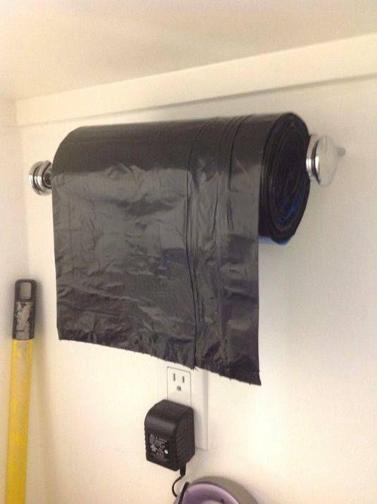 Repurpose a paper towel holder for trash bags.