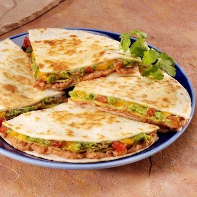Stack Refried beans, spicy tomatoes, cheese and avocado layered in tortilla and crunchy corn tostadasRefried beans, spicy tomatoes, cheese and avocado layered in tortilla and crunchy corn tostadas
