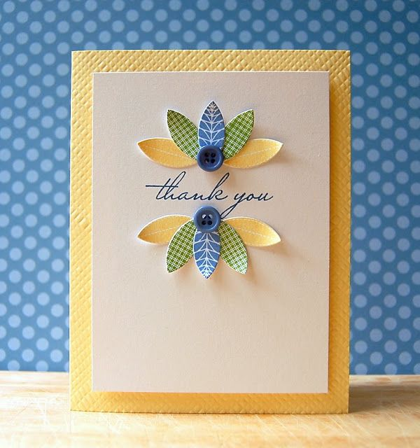 "Great use of either a die cut leaf or a stamp leaf to make a ""frame"" for the sentiment - and buttons are always great!"