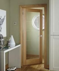 The distinctive diamond cut grooves in the Linear Oak Glazed Door adds interest while allowing plenty of light into the room. : glazed doors howdens - pezcame.com