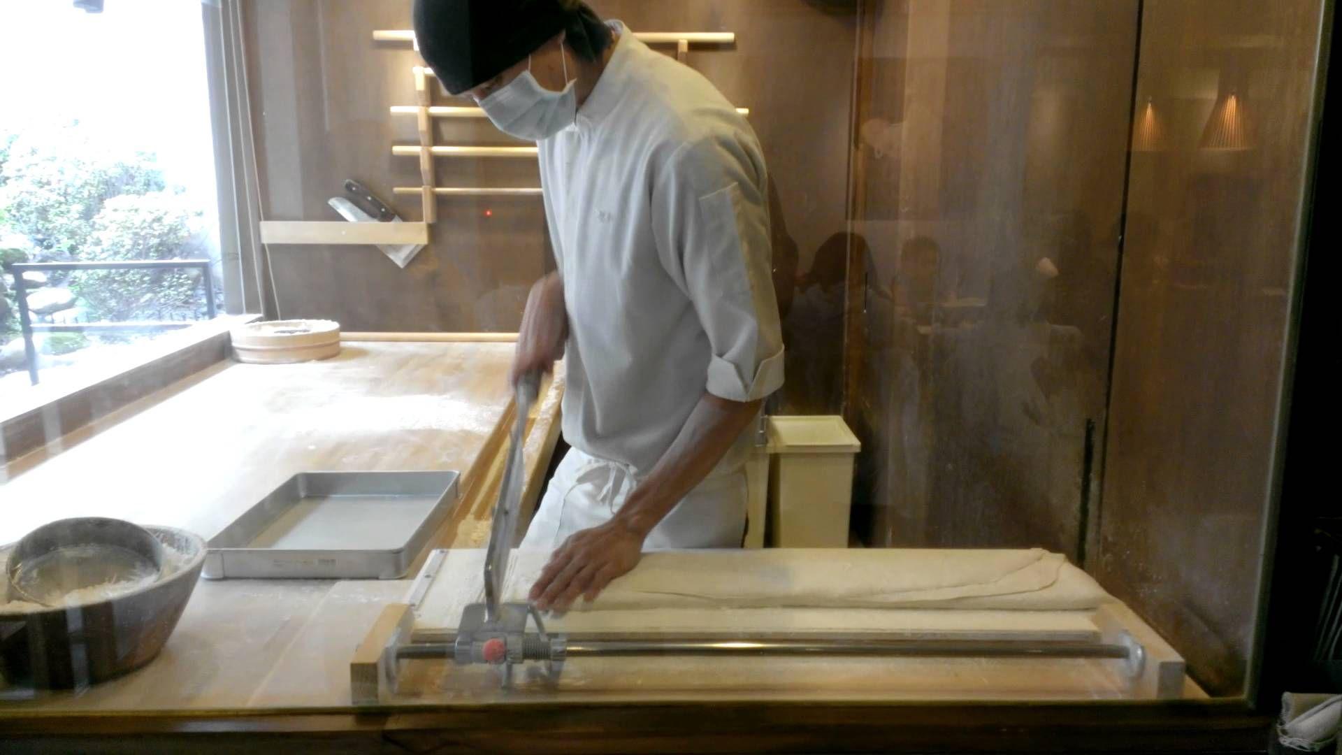 Professional chef making Japanese Teuchi udon noodles