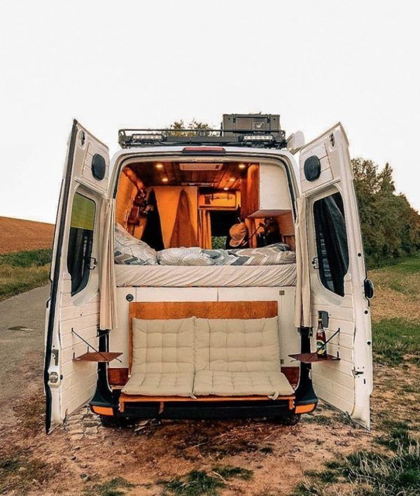 Couple's Van Life with a Tailgate Loveseat on their DIY VW Crafter Conversion