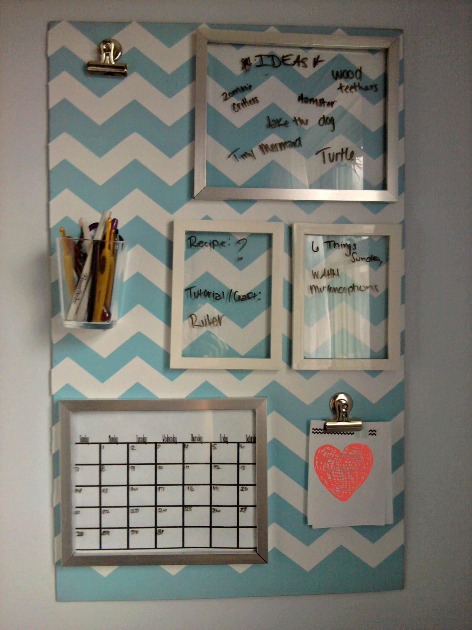Organization board! I like that the frames show the background of ...