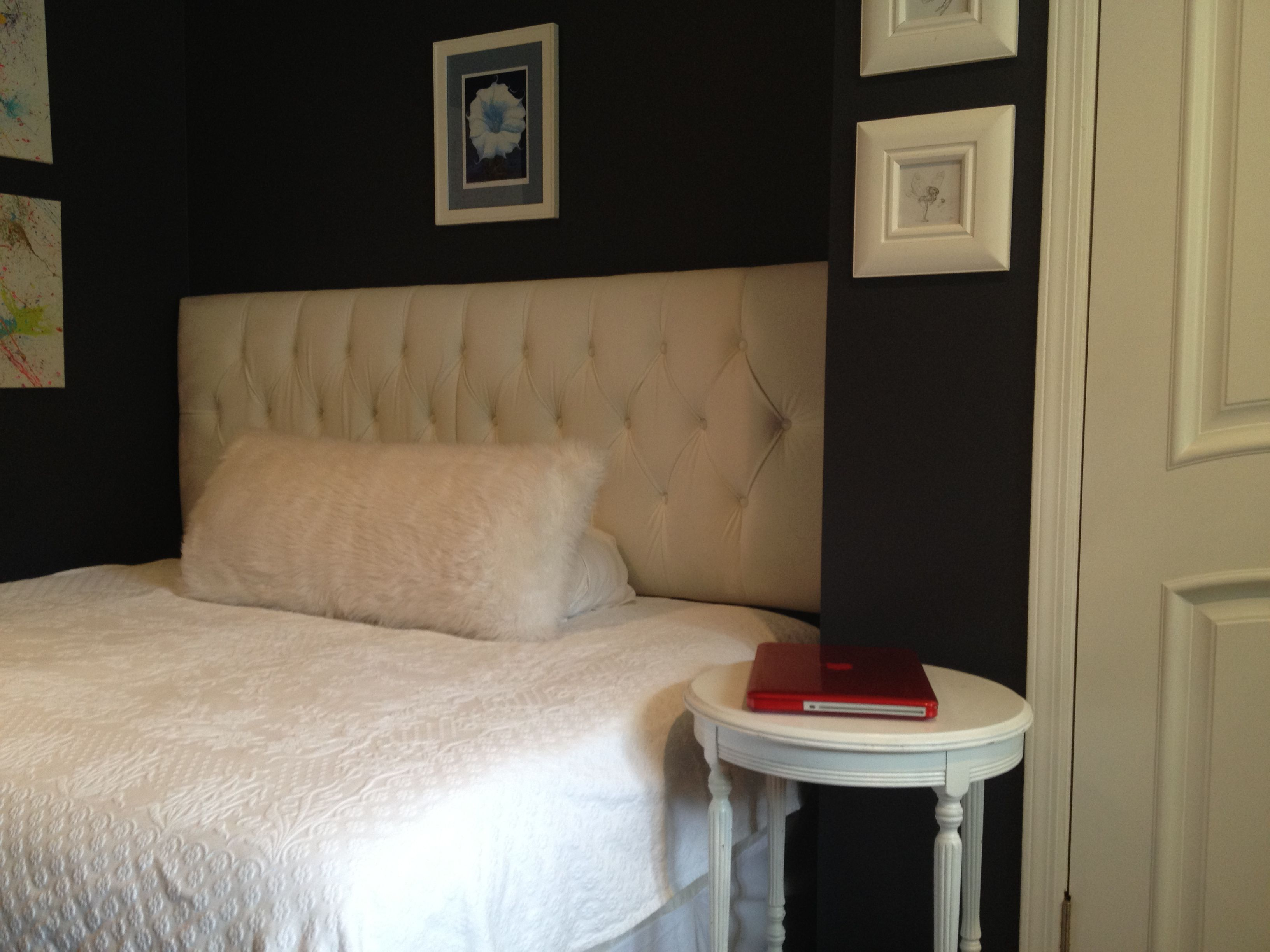 Full sized bed turned sideways on wall with a King sized headboard makes a great teen daybed By Cianci House Designs