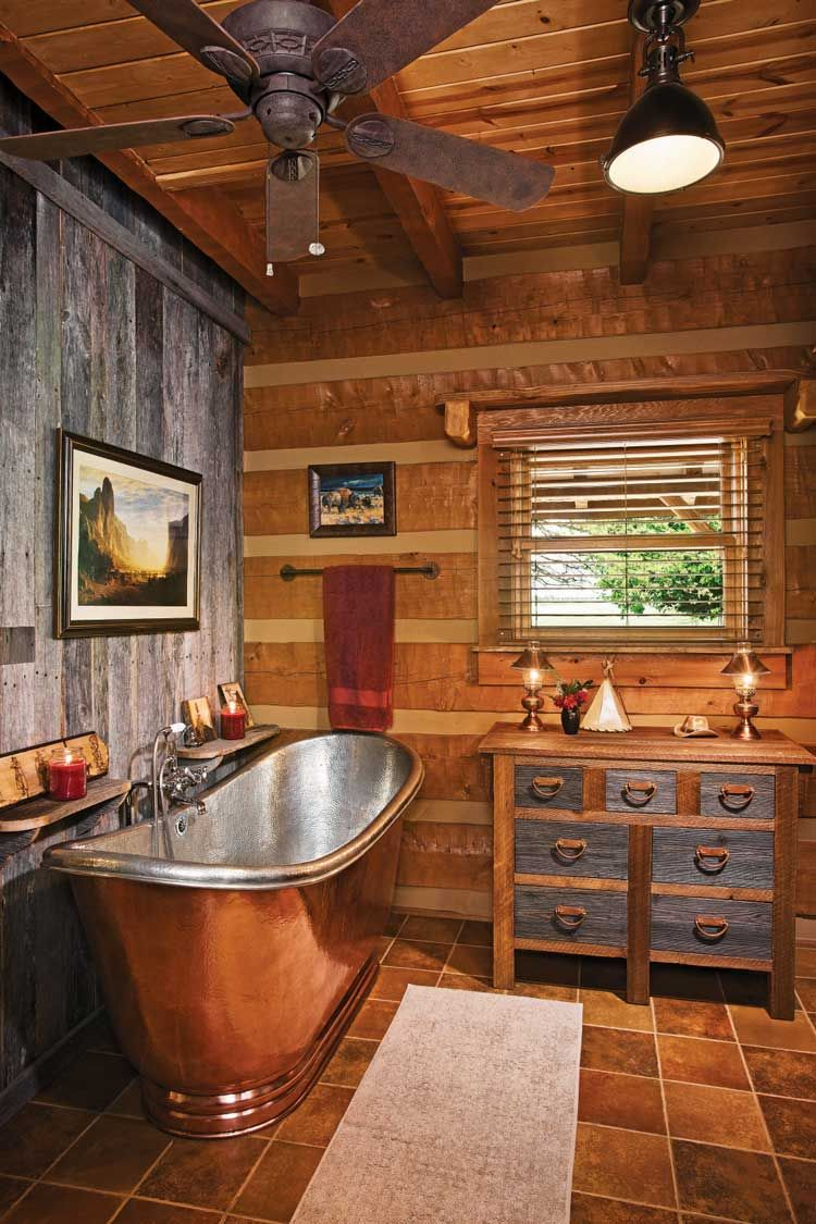 Rustic Bath Inspiration For The Vacation Home With A Terrific Copper Tub Love The Contrast Of The Logs Cabin Bathrooms Log Home Interiors Log Home Decorating