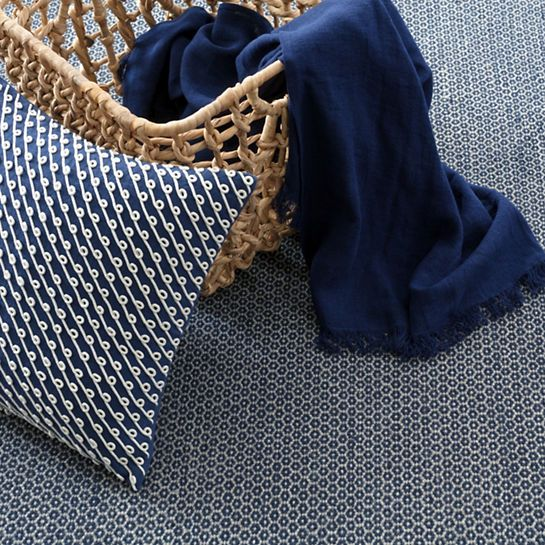 This petite-geometric woven wool area rug is the perfect backdrop for any room! Tightly woven for durability and versatility. Indigo/Grey.